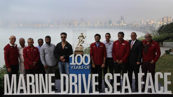 Tata Mumbai Marathon celebrates 100 years of the iconic Marine Drive Sea Face Aditya Thackeray & Tiger Shroff hold aloft the event trophy to mark the felicitation